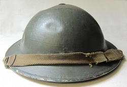 British Wardens Helmet with dents and post war green paint