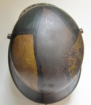 Top of M16 helmet worn paint and rust