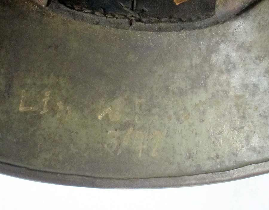 German helmet with owners name and unit